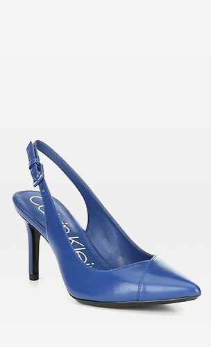 Blue leather pump on a grey background