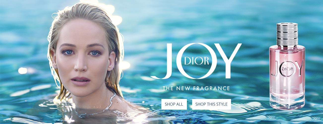 Creative shot of JOY by Dior with model in water